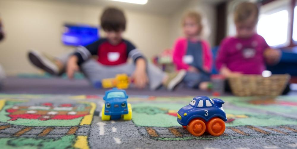 nursery children playing on a mat