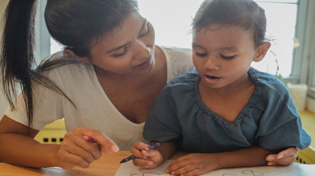 child learning at home with their parent
