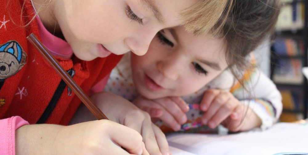 two children over a page