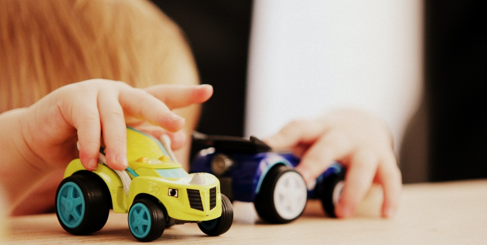 children playing with car toys