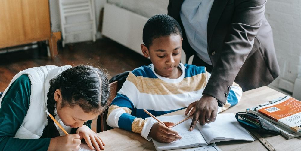 teacher helping child with work