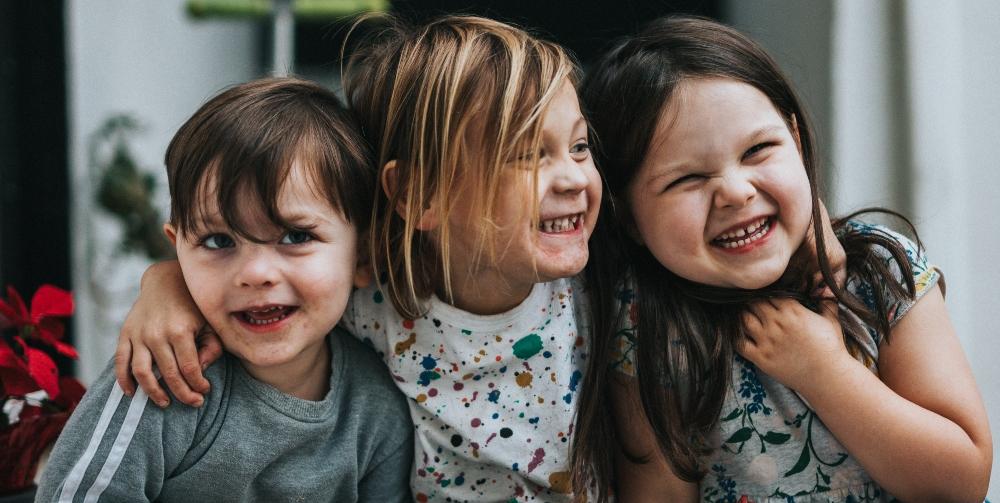 children sat down laughing