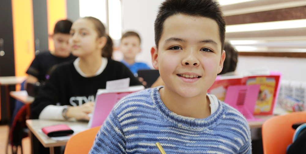 child smiling in classroom