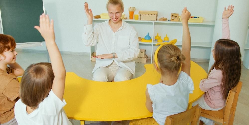 children asking teacher questions