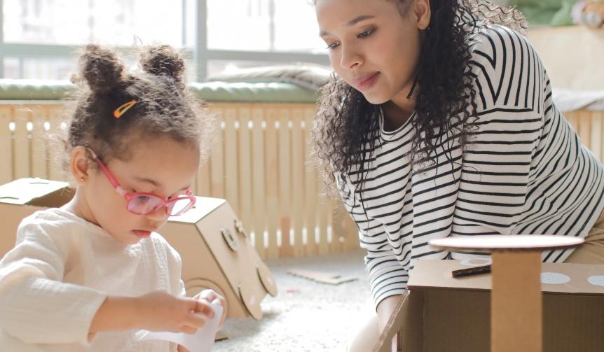 teacher working with child