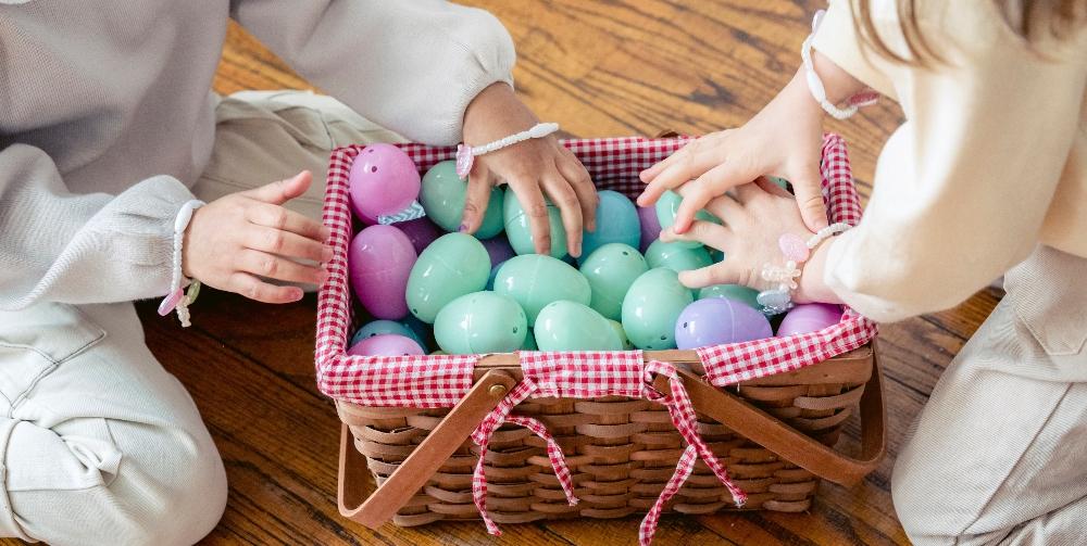 children placing plastic shapes in basket