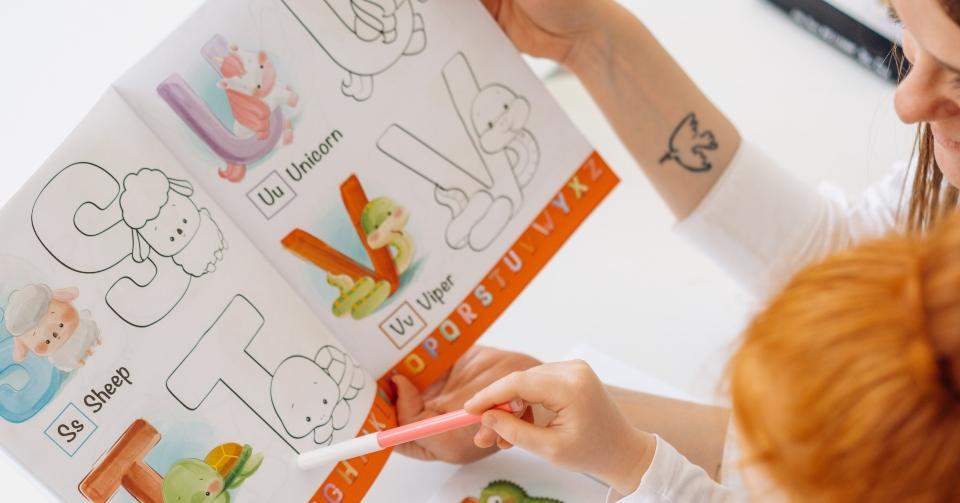 a girl learning the alphabet
