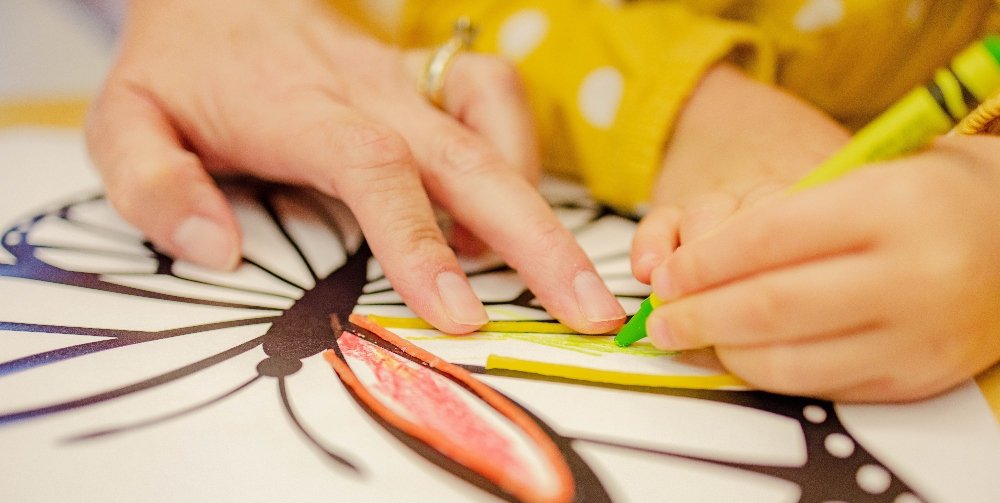 child colouring in a butterfly